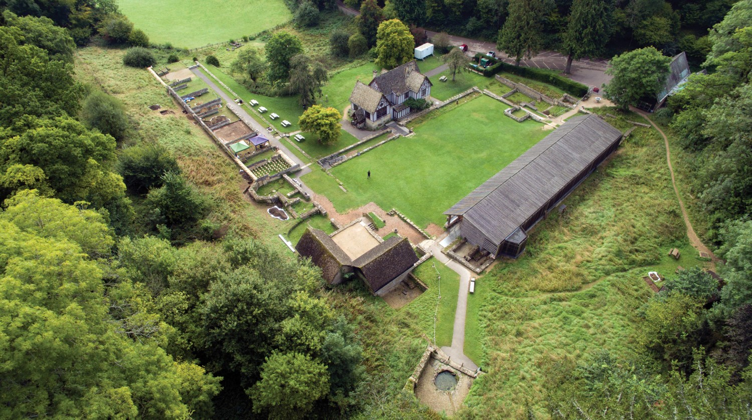 below This drone photograph (looking south-east) shows the extent of the villa complex at Chedworth: bottom centre we see the Nymphaeum, built at a natural spring, with bathhouses on either side of it. The North Range of villa buildings lie to the left, and the West Range to the right.