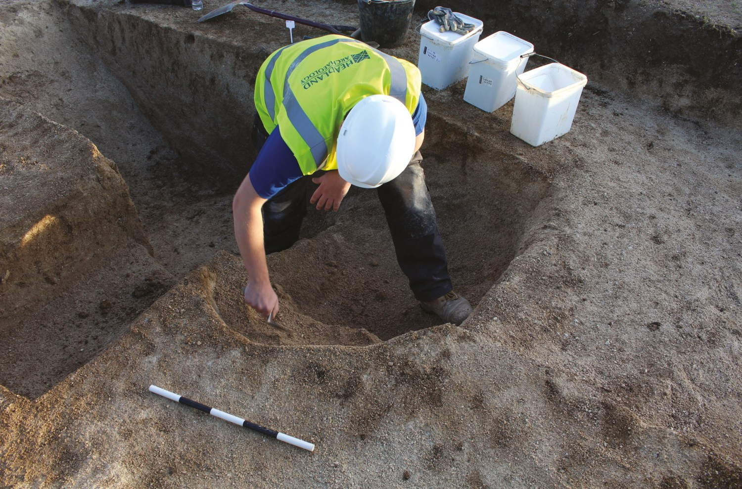 LEFT Headland Archaeology's investigations revealed features spanning the Bronze Age to the post-medieval period. One of the most significant finds was this grave cut, shown under investigation, which contained a Beaker-period infant burial.