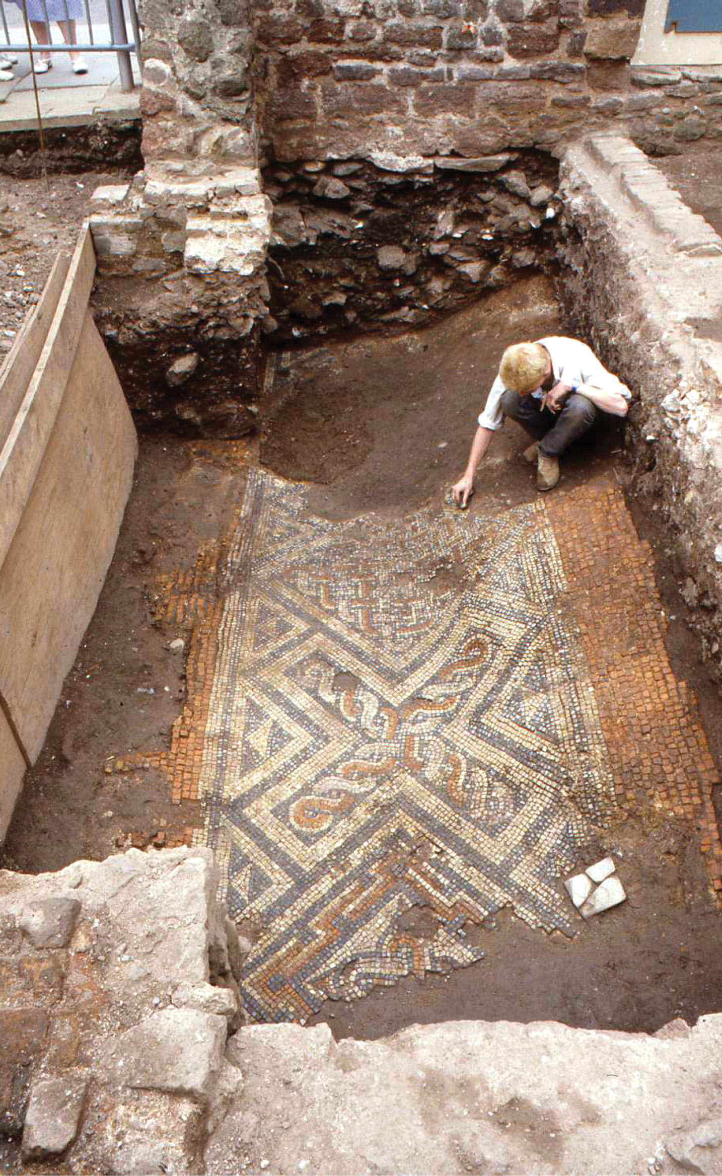 LEFT Echoes of Isca: this Roman corridor mosaic was revealed during excavations at St Catherine's Almshouses in 1987-1988. The centre of the mosaic has subsided markedly, as it overlay the uncompacted fills of the defensive ditch surrounding the early town.