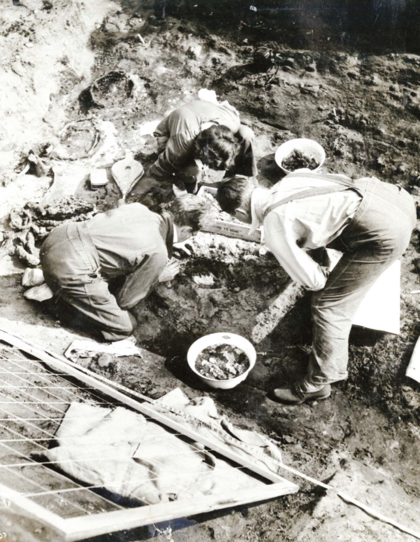 LEFT This photograph shows the 1939 dig team excavating the central chamber of the Mound 1 ship burial at Sutton Hoo. Peggy Piggott is pictured in the centre.