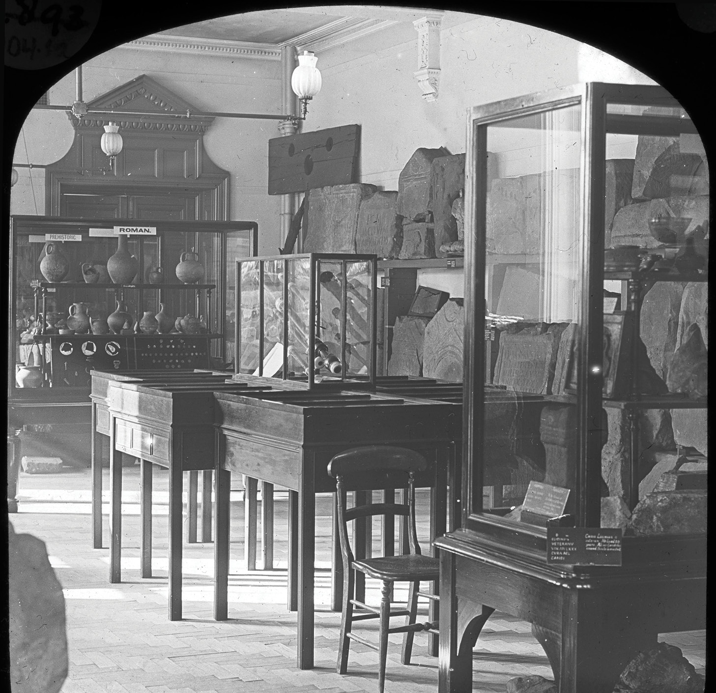 left Roman artefacts on display at the Chester Museum, late 19th or early 20th century (HEIR ID 59688). The photographer is unknown, but the image offers interesting insights into how exhibits like these were presented it seems that there was an expectation of prior knowledge on the part of visitors.