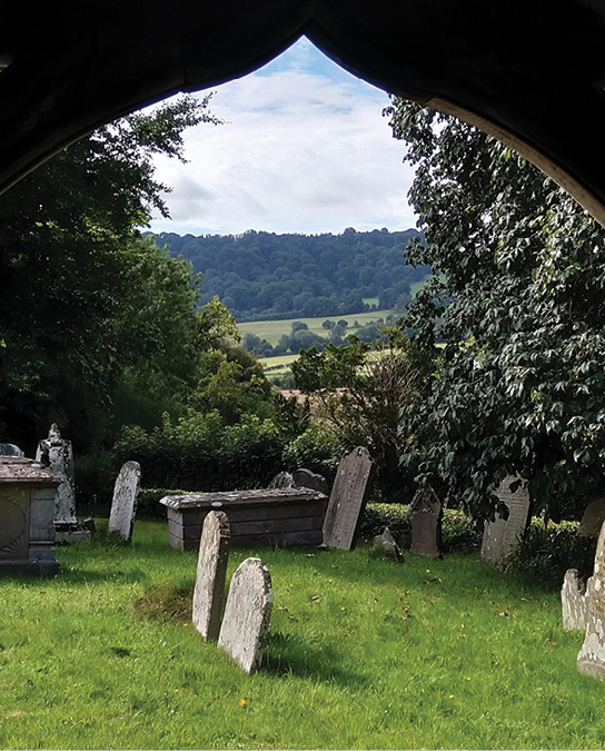 above left 'He being dead yet speaketh': a prophetic quote from Hebrews 11:4 on the Reverend Kilvert's grave in the churchyard of St Andrew's church, Bredwardine (Herefordshire), where he served as rector from 1877 until his death in 1879. ABOVE RIGHT In his diary entry for 2 January 1878, Kilvert records a visit from his parents. His father, the Reverend Robert Kilvert, rector of Langley Burrell (Wiltshire) and a keen antiquary, 'especially admired the old Norman 12th- or 13th-century work in the Church and more particularly… the carving over the Devil's Door' (the north door, shown here). Above On 3 March 1878, Kilvert wrote lyrically of the view through the south porch: 'the fresh sweet sunny air was full of the singing of the birds and the brightness and gladness of the spring. Some of the graves were as white as snow with snowdrops… the whole air was melodious with the distant indefinite sound of sweet bells.'