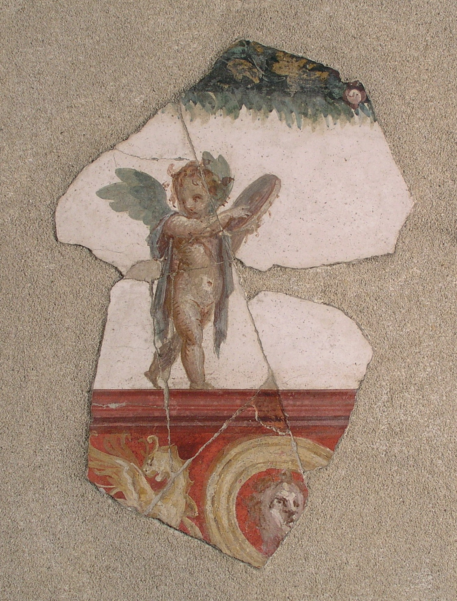 above Wall-painting with a cupid playing a tympanum (a hand drum). Villa San Marco, 1st century AD.