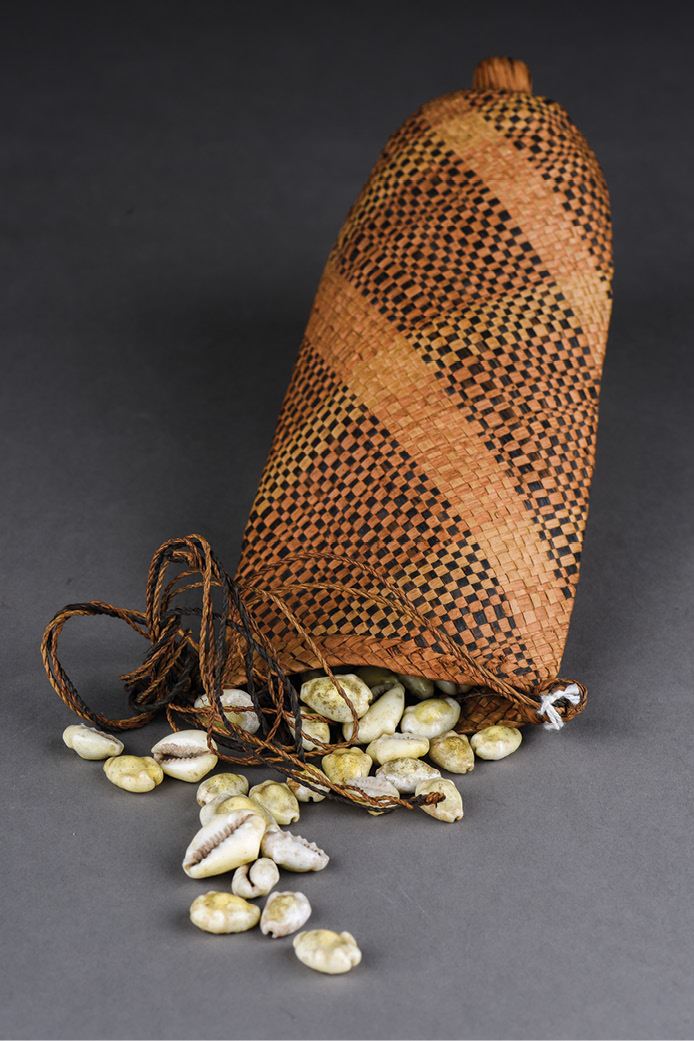 left & BELOW Cowrie shells and manillas were used as currency in West Africa. Some manillas were made in Britain to be used as part of the slave trade.