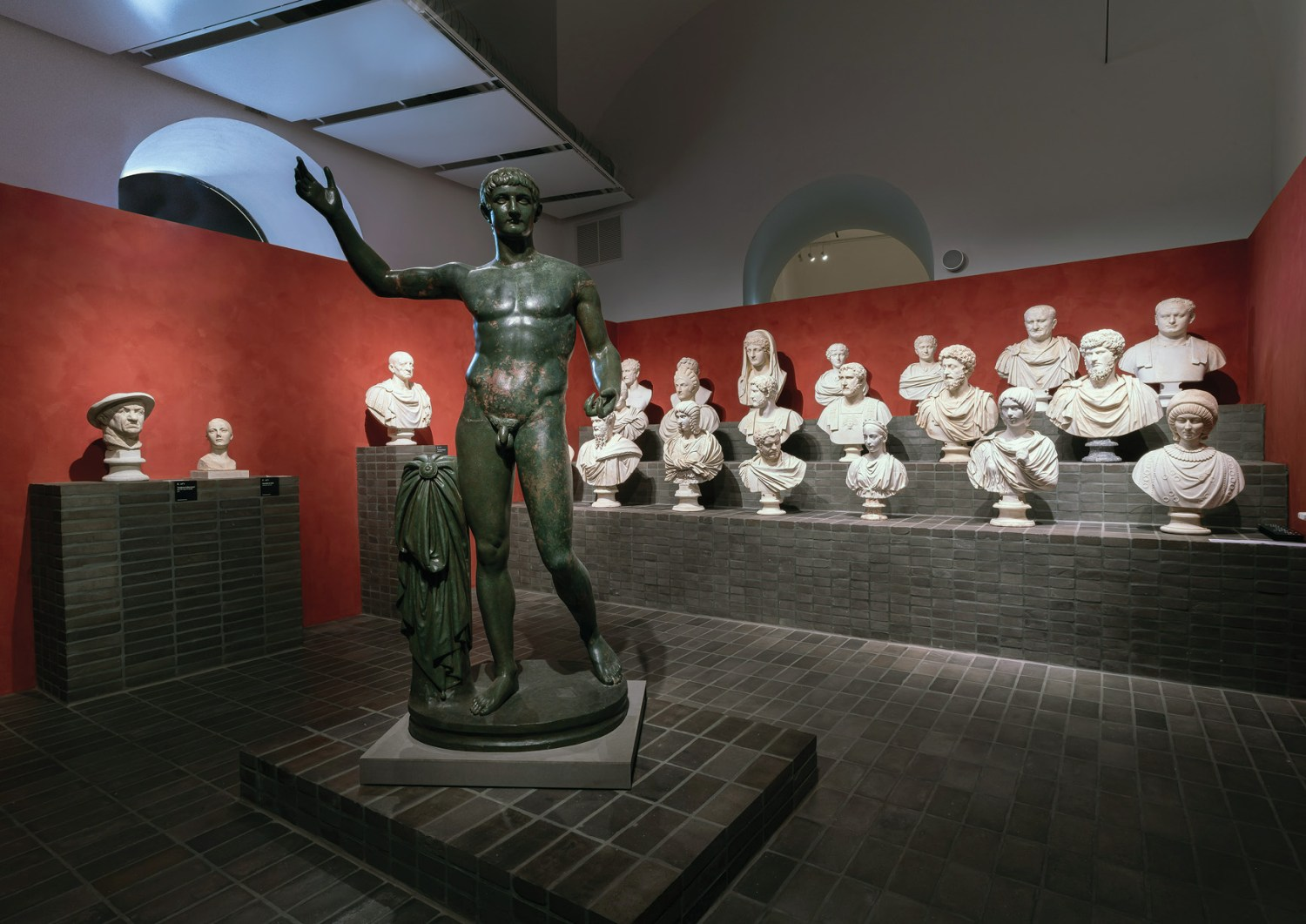 ABOVE The bronze statue in the foreground was found in the ancient city of Cures, and has been reconstructed to show Germanicus, the adopted son of the emperor Tiberius. The head, right leg, and much of both arms are plaster reconstructions, though, leaving the true identity of the figure unknown. In the background, various busts from the collection can be seen.