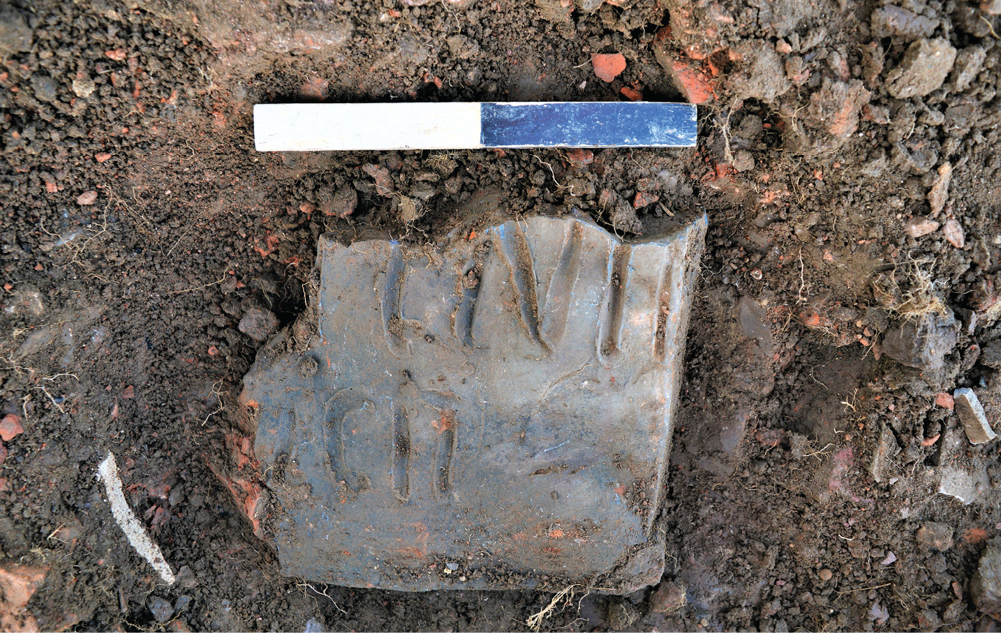 BELOW Does this inscribed tile bear part of the name of one of the tilers who worked on the site?