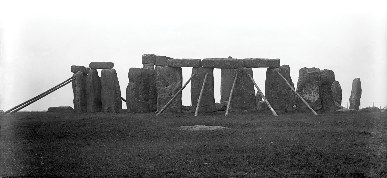 above Stonehenge in the late 19th or early 20th century (HEIR ID 36121; photo by R W Wylie), showing the wooden props that once supported some of its stones.