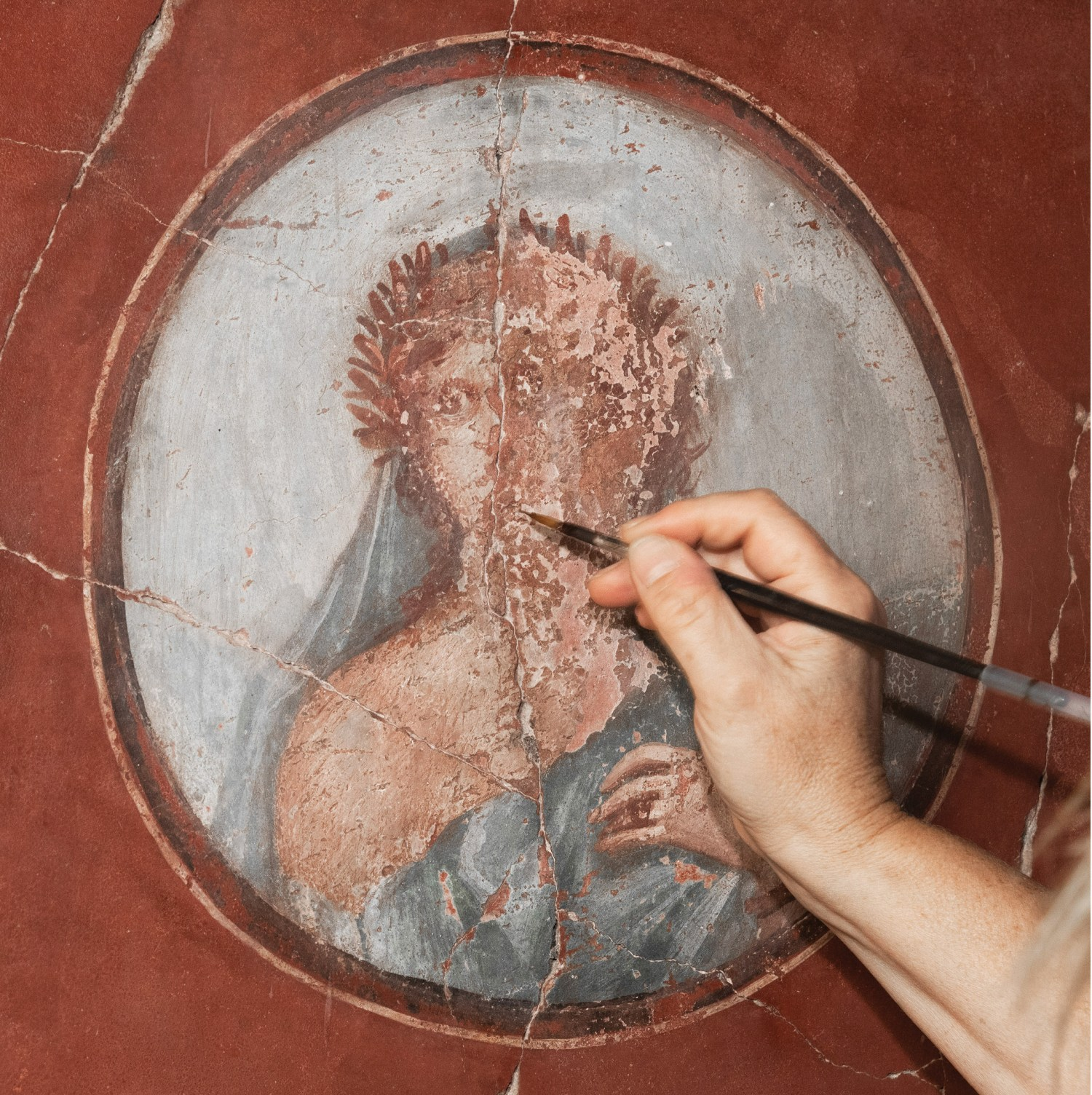 above Conservators carried out minimal in-painting in neutral tones, limited to areas of damage and loss. This approach allows visitors to appreciate the artistic quality of the paintings, while retaining archaeological information, and respecting the approach taken in 1938 to exhibit the wall-paintings as recomposed fragments.