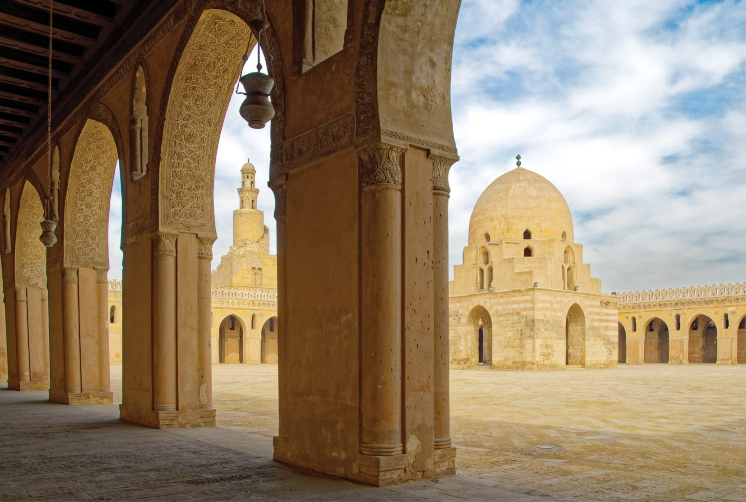 Above The serene Great Mosque of ibn Tulun, built in the 9th century, still stands in bustling modern Cairo. From the side arcades, the fountain pavilion built in 1296 by Sultan Lajin during his restoration of the mosque acts as the focus point.