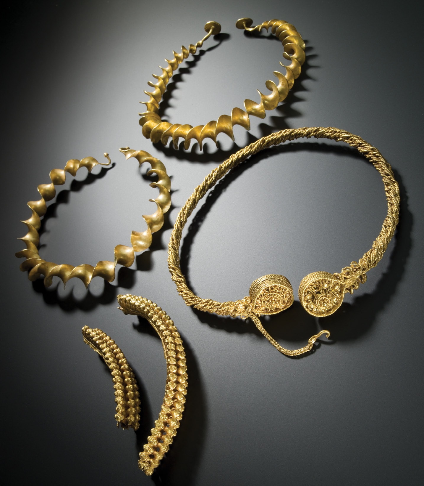 LEFT During later prehistory, bogs attracted offerings ranging from everyday objects like farming tools and food vessels to more valuable artefacts. These gold torcs are known as the Stirling Hoard, an Iron Age collection of jewellery found in boggy ground near Flanders Moss, Perthshire; they combine indigenous and Mediterranean design elements, and are today held by the National Museum of Scotland see www.nms.ac.uk/explore-our-collections/stories/scottish-history-and-archaeology/iron-age-gold-torcs/ for more information.