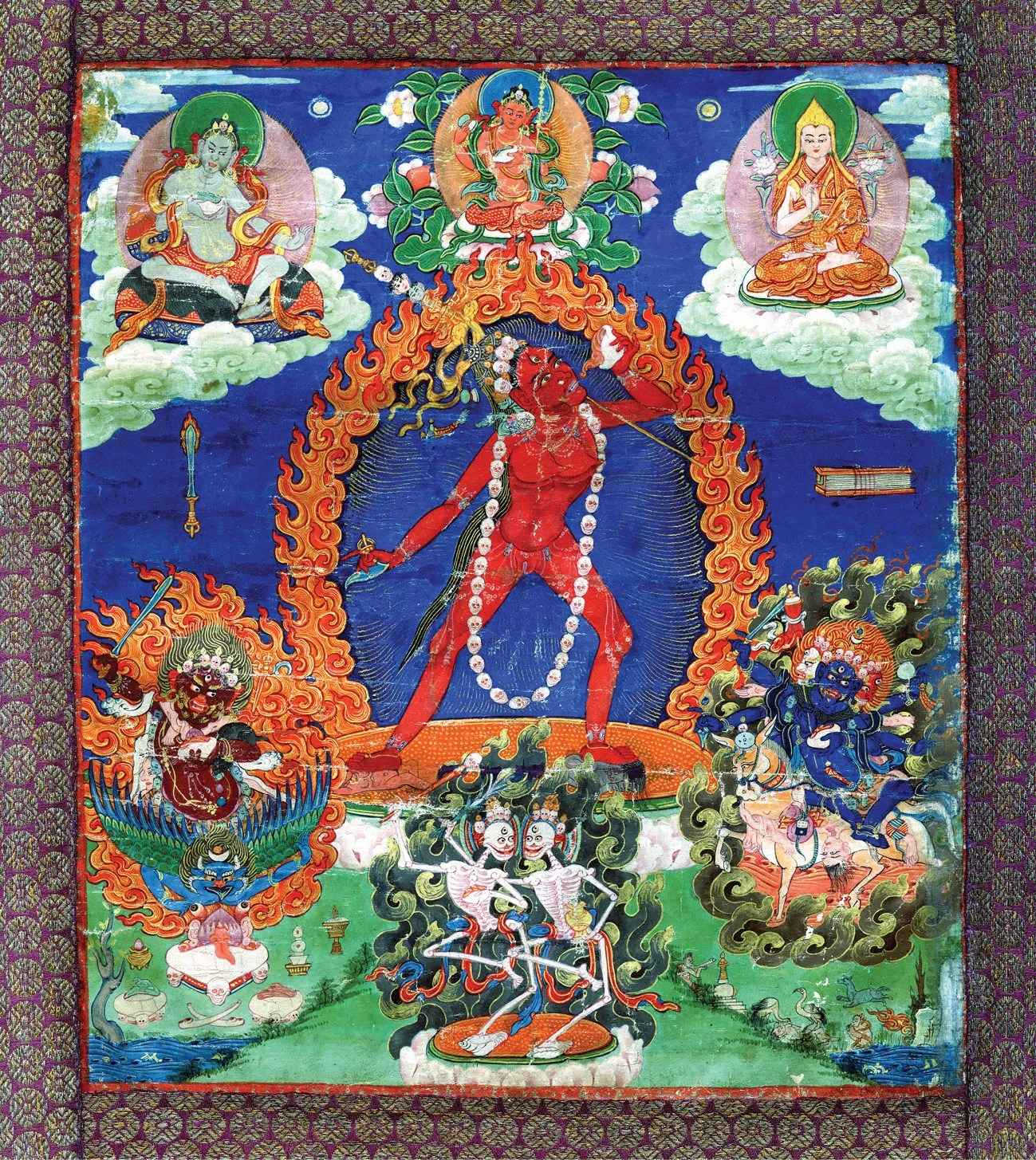 ABOVE Thangka painting of the goddess Naro Dakini (a form of Vajrayogini), Tibet, 18th-19th century. Ink and watercolour on cloth, with silk brocade borders. Size of painting: 26.3 x 23cm