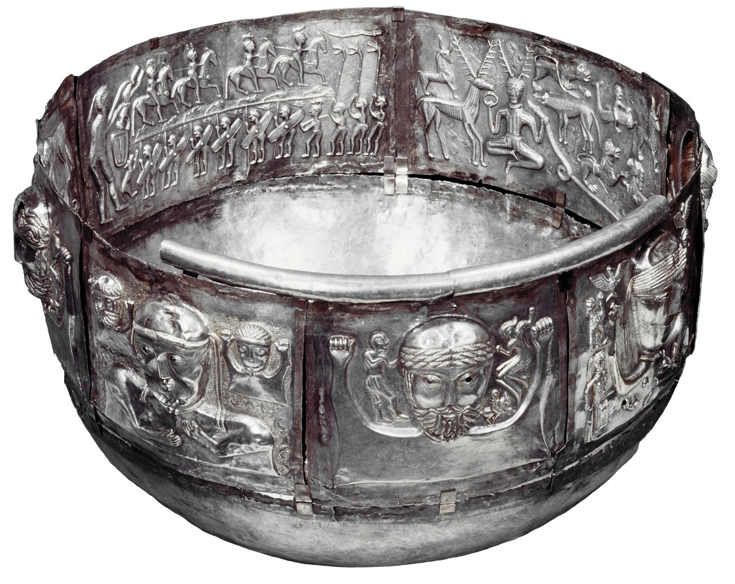 ABOVE Carnyx-players carrying animal-headed war horns process around the inside of the Gundestrup cauldron. This elaborate vessel was itself placed in a Danish bog, while the remains of instruments like those depicted here have been recovered from wetlands in continental Europe and Scotland.