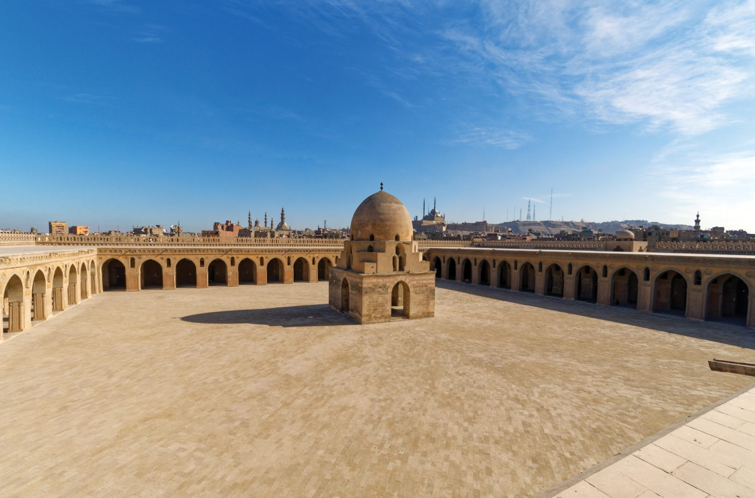 previous page The inner (left) and outer walls of the mosque immediately create a quiet space after entering the mosque precinct from the busy streets of Cairo outside. To the right stands the 1357 complex of the Mamluk amir Sarghatmish. above The Great Mosque of ibn Tulun consists of arcades on four sides, surrounding a large open court.