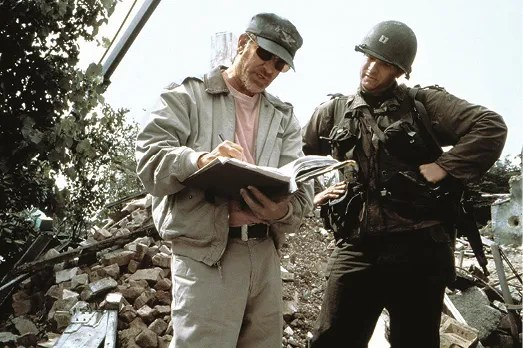 LEFT Steven Spielberg with Tom Hanks on the set of Saving Private Ryan, the 1998 film which has since spawned several wartime miniseries.
