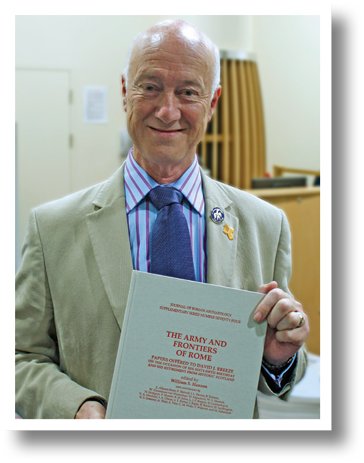David Breeze accepts his festschrift, prepared in secret, and presented at the Limes