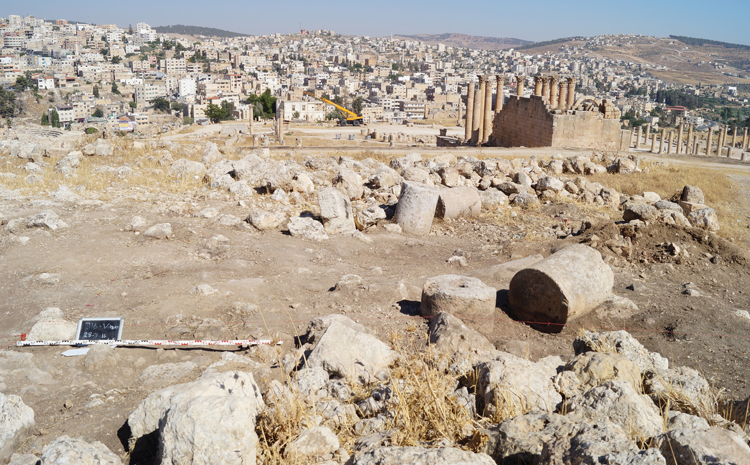 LEFT The beginning of excavations in 2016. Trench V is laid out to investigate the House of the Tesserae further. The modern city and the Temple of Artemis are seen in the background. For little more than a month, soil is removed, finds are recorded, and structures are preliminarily interpreted (below). The sound of Jerash accompanies the work: voices of schoolchildren singing the national anthem every day at 8am; bagpipe shows being practiced in the hippodrome south of the ancient town; and 'La Bamba' at full blast when the gas-cartridge salesman is nearby. Tourists flood along the colonnaded street, but some are attracted by the busyness on the hill, and venture up to find out what is going on.