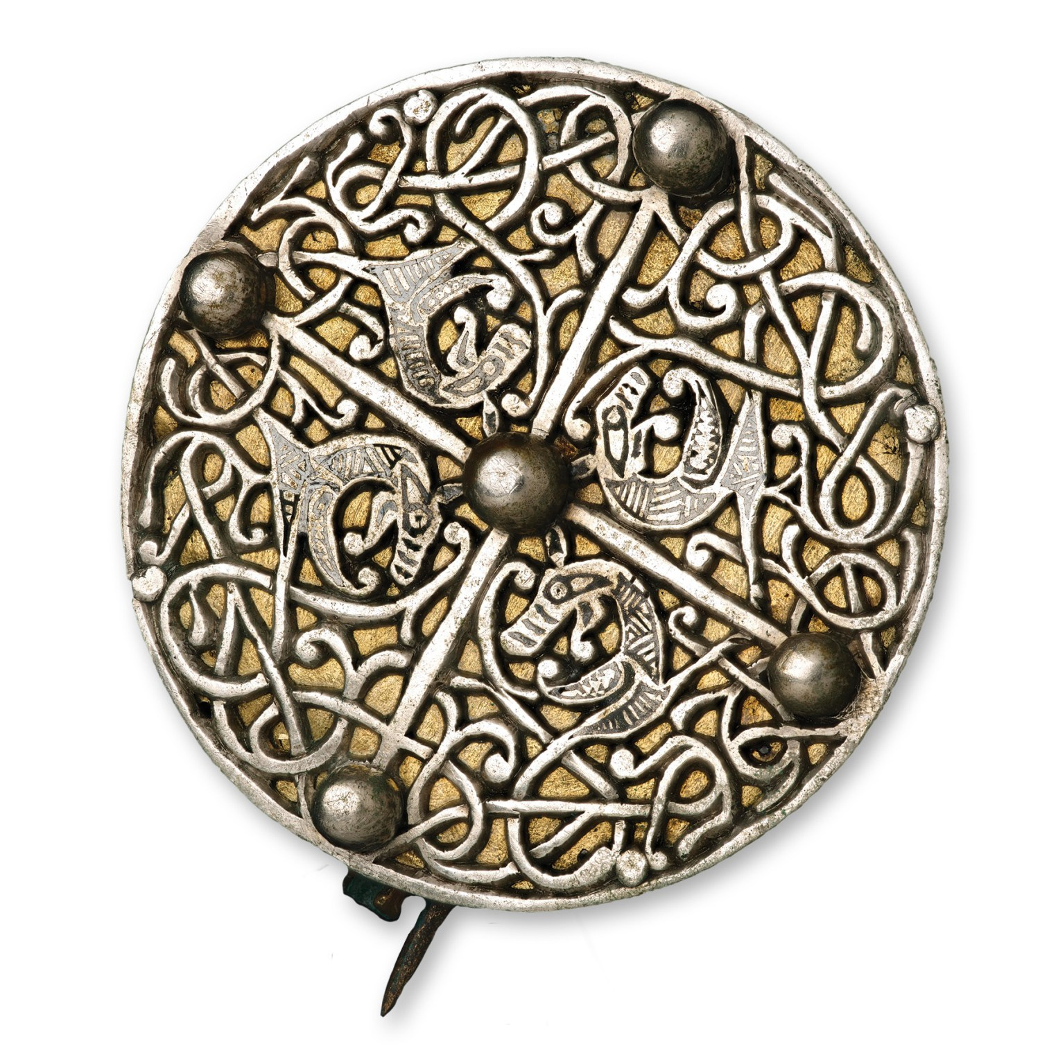 LEFT Disc-brooches like this example from the hoard are more commonly associated with the Anglo-Saxon kingdoms of southern and eastern England; the fashion did not reach Scotland. The presence of so much Anglo-Saxon artistry from brooches and the pectoral cross to carved runes in a 'Viking' silver hoard raises intriguing questions about how it came together, and the significance of its discovery in Galloway, which was described as 'the Saxon coast' in Irish sources.