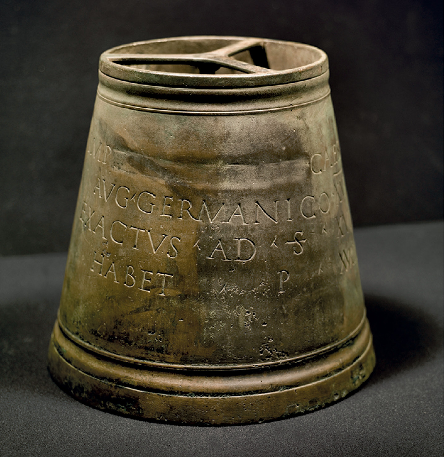 left This copper alloy modius (grain measure) was found at Carvoran in 1915. It dates from the reign of the emperor Domitian (AD 81-96), and, while its inscription claims it had a capacity of 38 pounds, its true volume is markedly less.