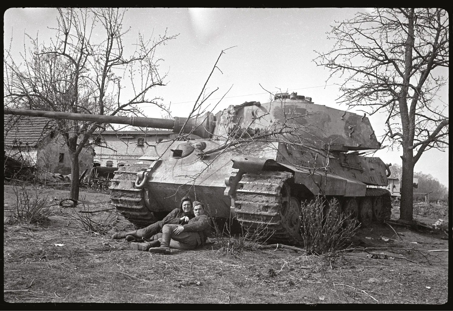 LEFT Soviet soldiers pose in front of a captured King Tiger in April 1945.