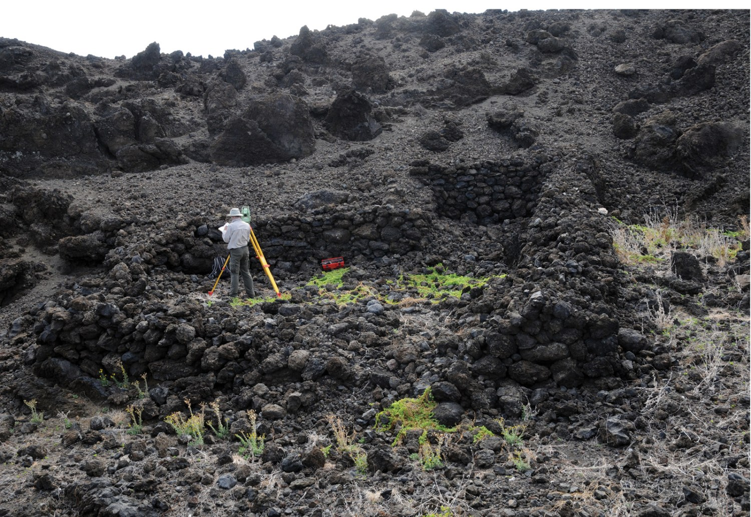 right Survey underway at heiau site ALE-140. The temple measures about 10m by 10m, with a notch creating a small room.