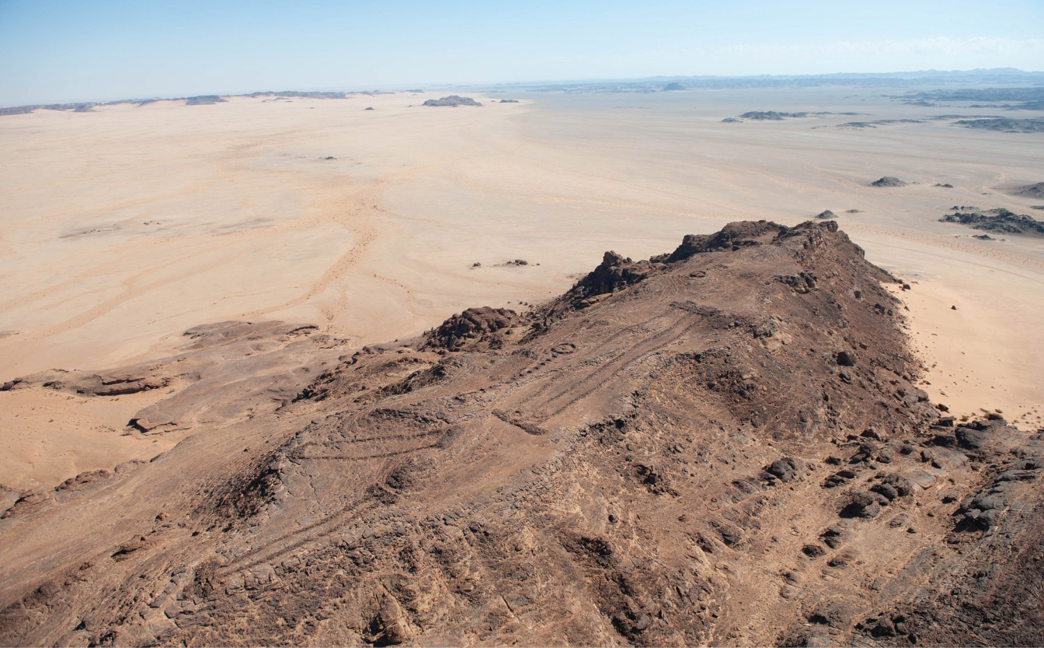 above A group of three mustatil on top of an isolated elevation in the landscape, a location commanding extensive views over the surrounding lowlands. More than 1,000 of these prehistoric monuments have been recorded in north-western Arabia.