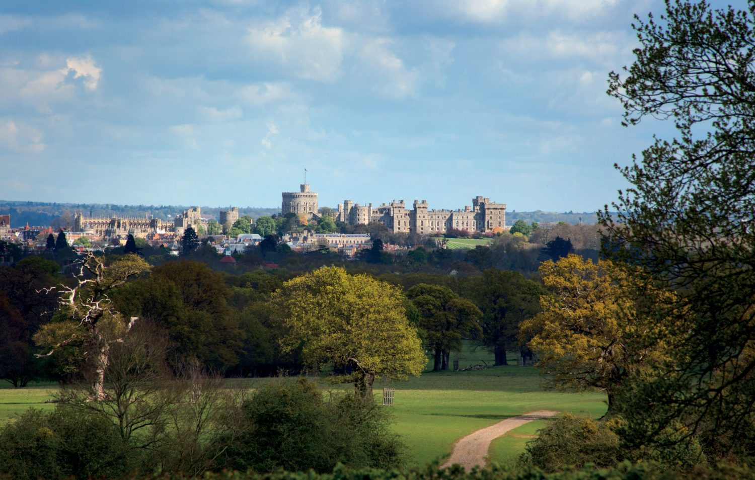 left Windsor Castle today, seen from the Great Park to the south-east. The basic outline of the castle, with the Round Tower in the Middle Ward, the adjoining Upper Ward (today containing the State Apartments), and the Lower Ward (with St George's Chapel) had been established by the early 12th century, when the castle was transformed from a garrison into a royal residence.