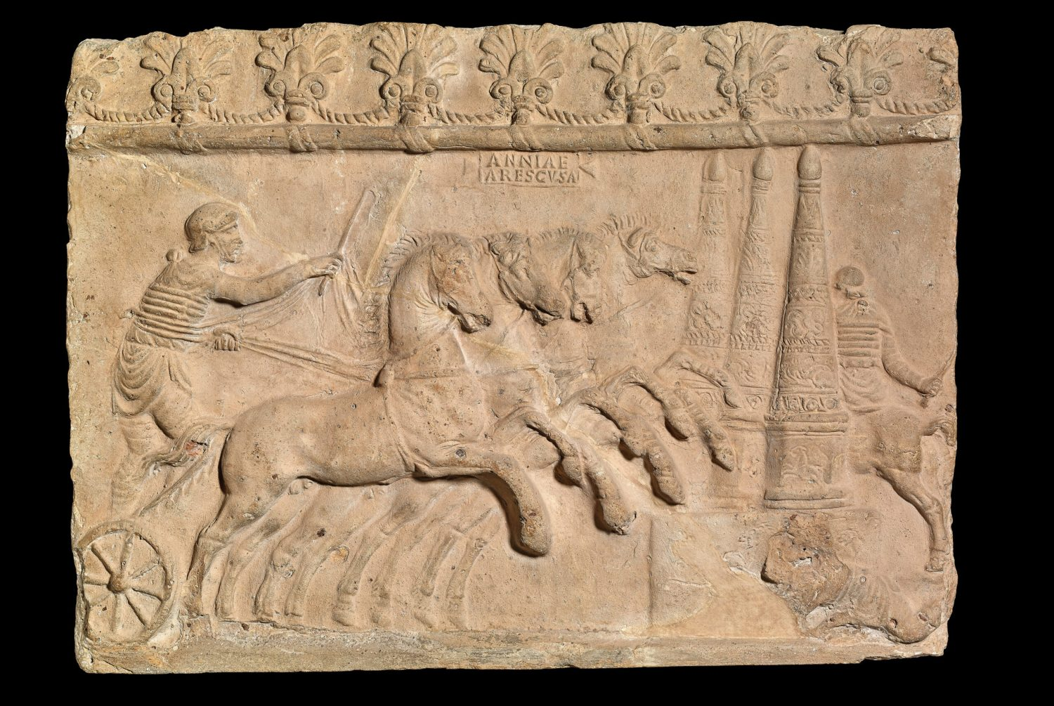 left Relief showing a chariot race, Italy. Terracotta, AD 40-70. Size: 30.5 x 40.6 x 3.5cm