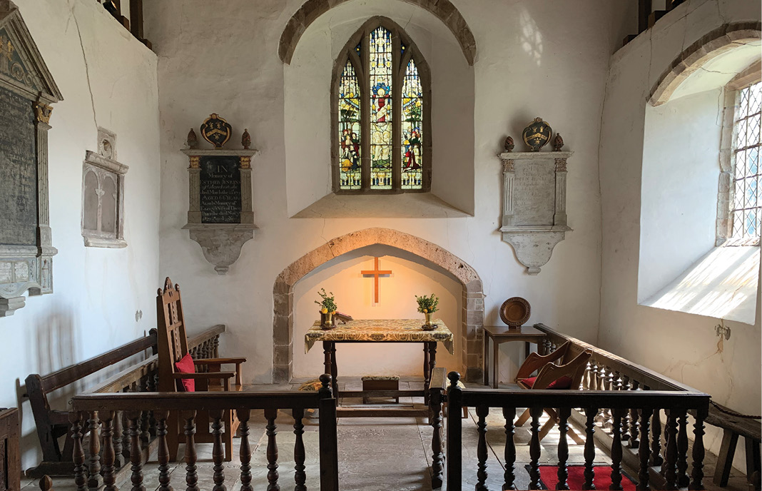 BELOW The chancel at Clodock (Herefordshire) reflects 16th-century Protestant reforms: the altar has been replaced by a Communion Table, and memorials inhabit the floor and walls of a space from which the congregation was previously excluded because this was regarded as the priest's part of the church.