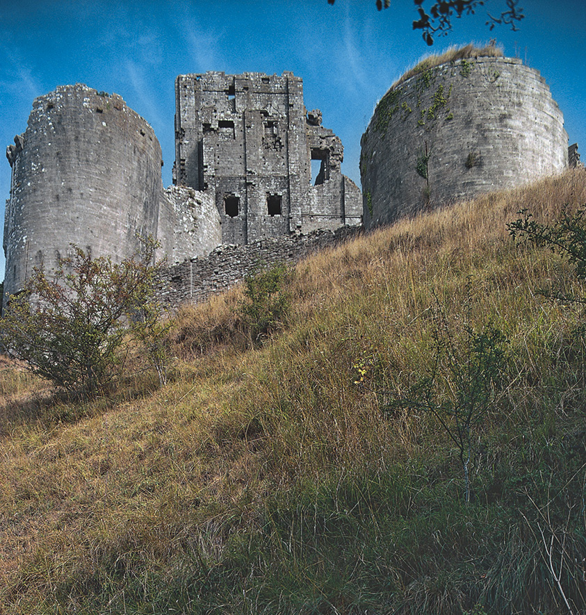 right Corfe Castle is an example of a castle so strongly associated with royalty that it was singled out for slighting during the English Civil War, and left in a state where it is now almost impossible to reconstruct the luxurious appearance of the castle in its heyday.