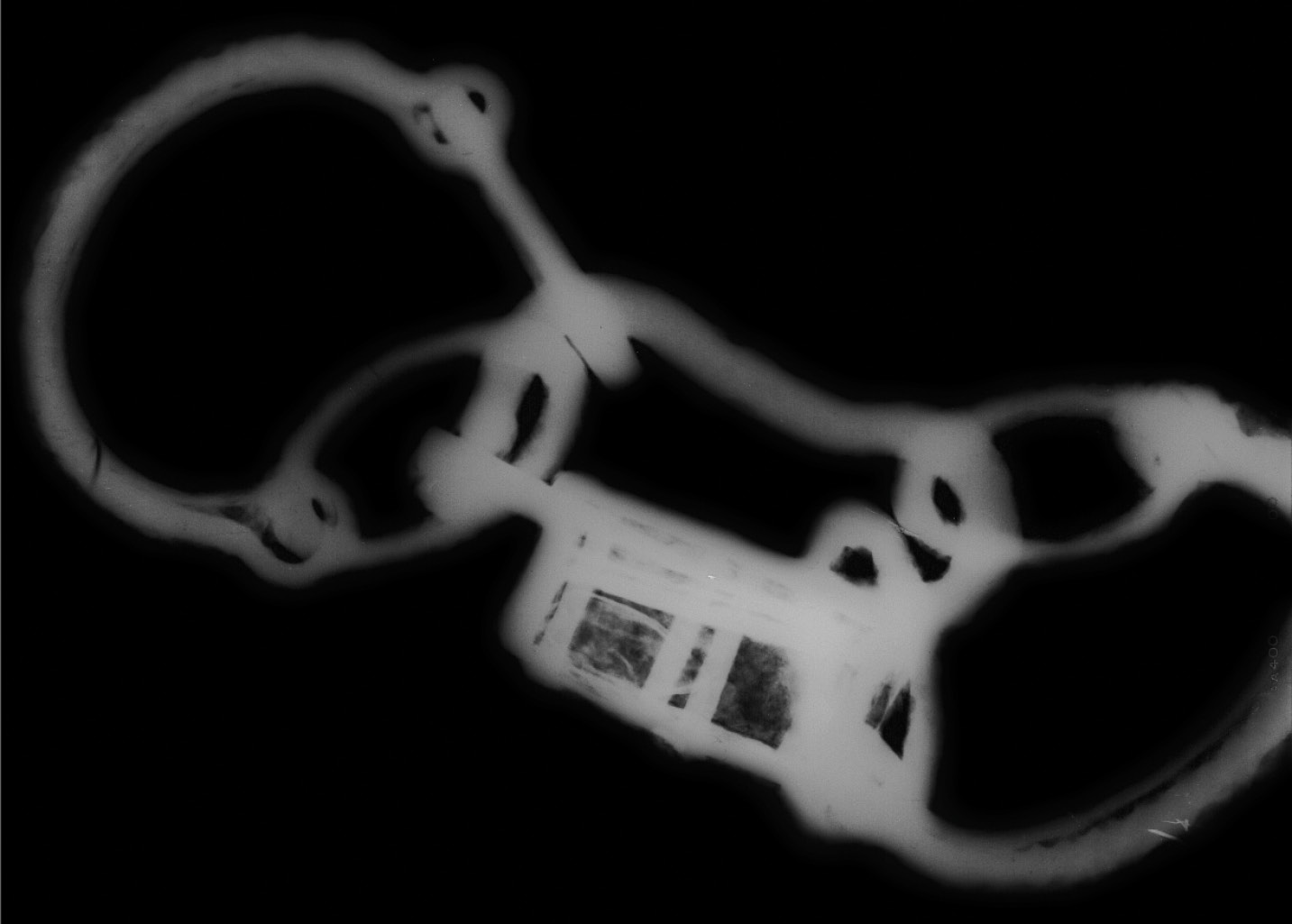 BELOW The fetters and their padlock were very corroded, but X-ray imagery reveals some of their details. They would have allowed their wearer to shuffle slowly, permitting work but preventing running away.