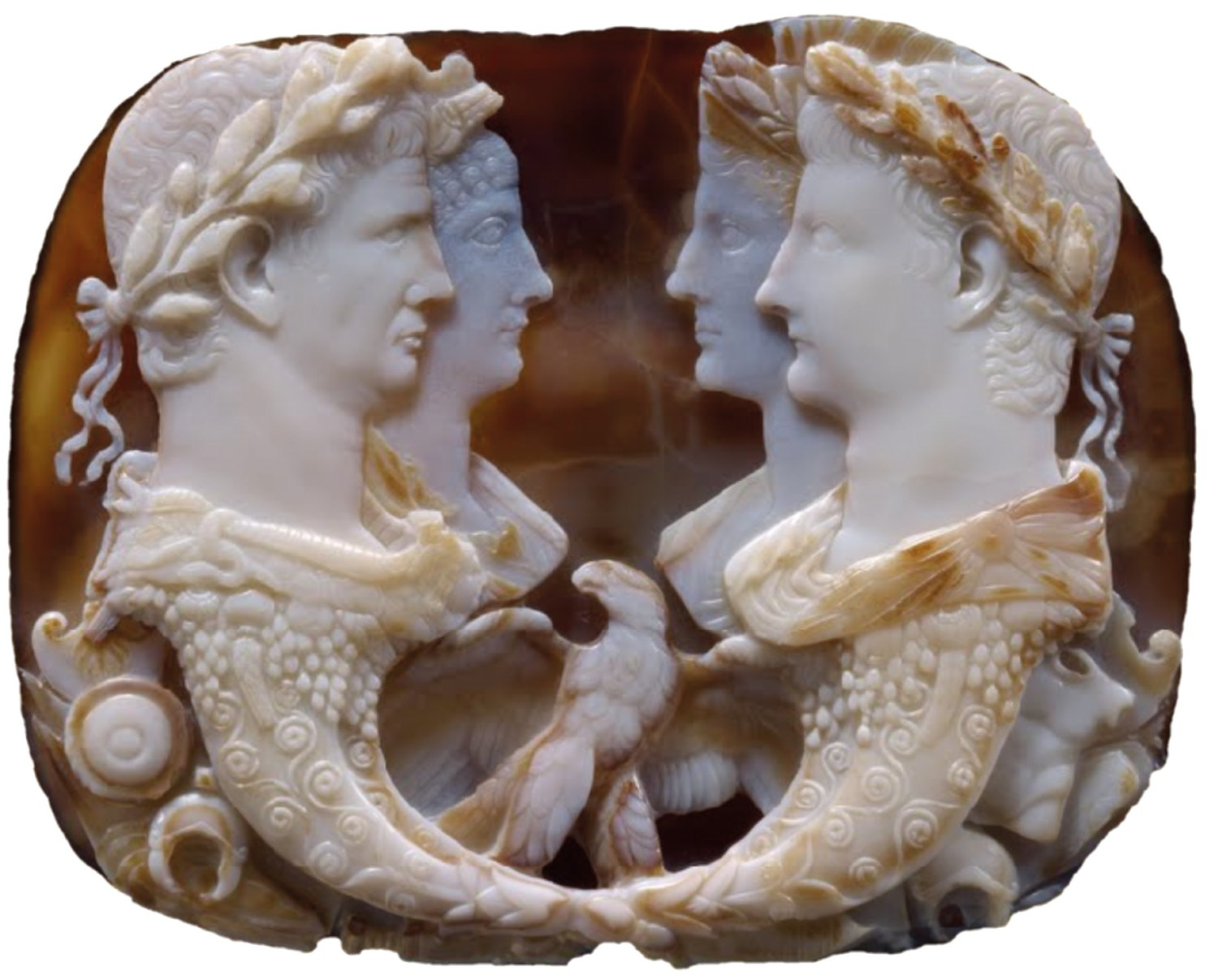9. The Gemma Claudia, a five-layered cameo, sardonyx, circa AD 49, showing Claudius and Agrippina the Younger (left) and her parents, Germanicus and Agrippina the Elder (right). The design symbolises the integrity of the dynasty through the combined descent from Augustus and Livia. H. 12cm. Photograph: Gryffindor. 10. and 11. Bronze coin, AD 41 48, showing Messalina, Claudius' third wife and first empress (obverse). The coin unofficially gives her the Greek equivalent title of Augusta (CEBACTH), a title she did not receive in life. The reverse shows Zeus Aëtophorus. D. 18mm. Photograph: Classical Numismatic Group. 12. and 13. Egyptian silver tetradrachm, AD 64 65, from Alexandria, with Nero (obverse) and Poppaea (reverse), his second wife, who was made empress in AD 63. D. 24mm.