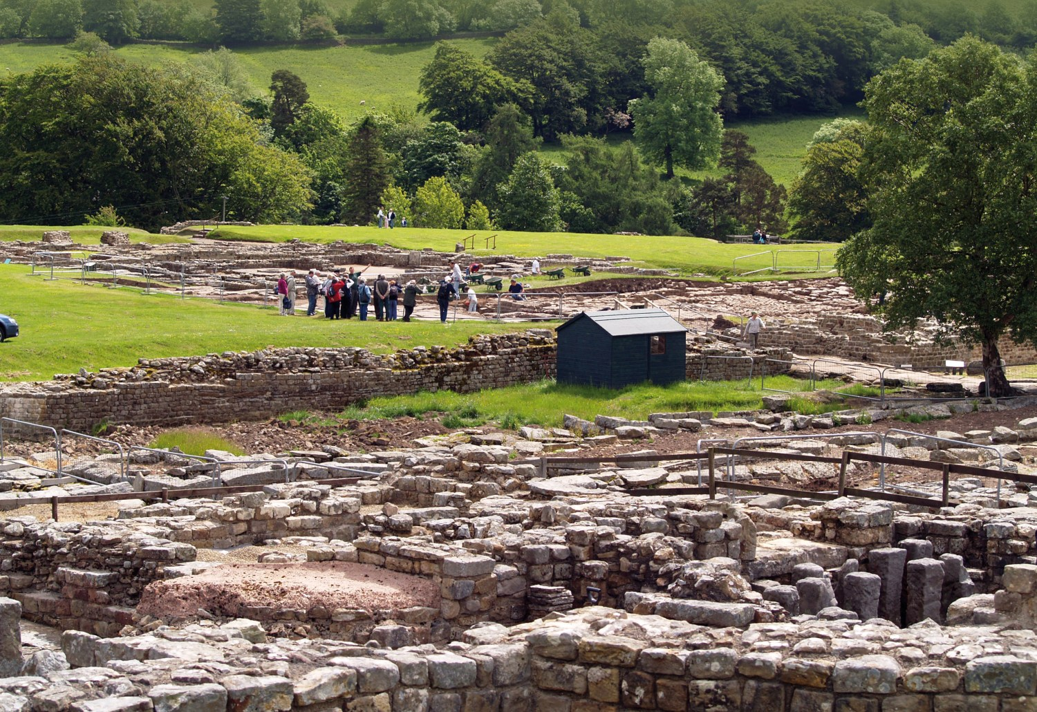 Below A view of Vindolanda looking towards the 3rd century fort from the apse of the bath house.