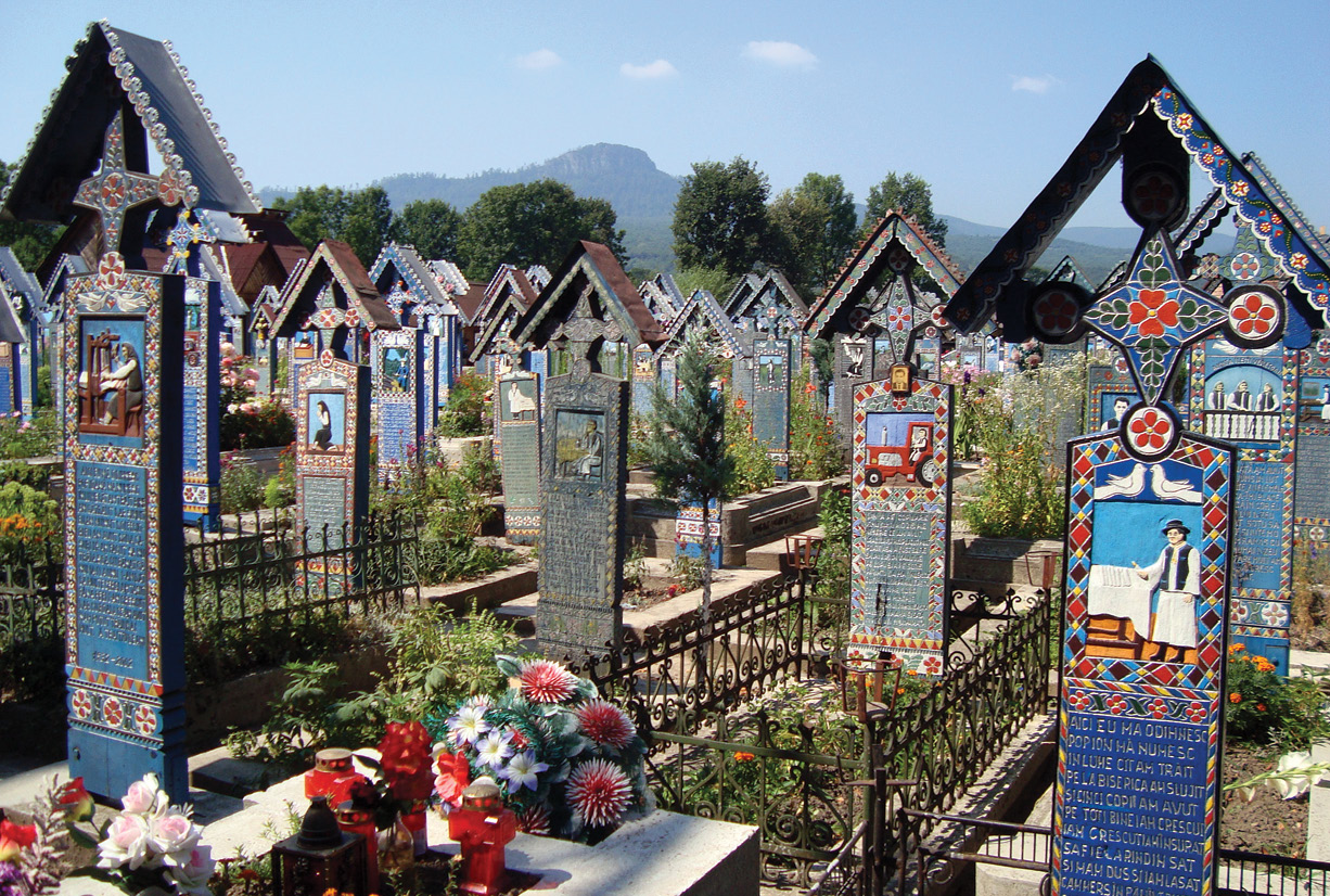 LEFT The cemetery in the village of Săpânța in Romania has more than 1,000 elaborately painted and carved oak crosses that depict scenes from the life of the deceased with brief epitaphs, warts and all.