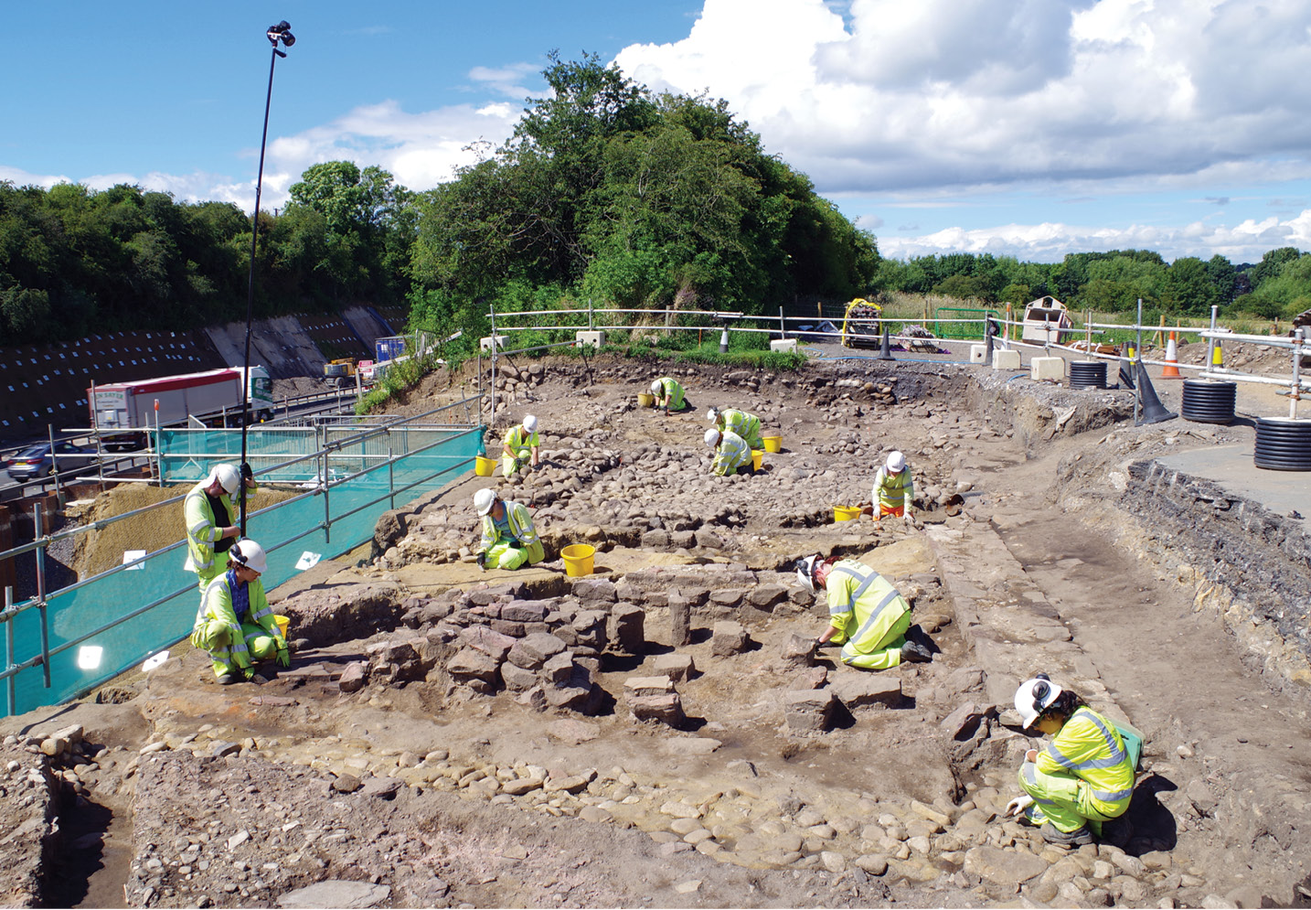 left Excavating a 3rd-century sandstone structure with a hypocaust at Fort Bridge. The room with the hypocaust represents a later remodelling of the building.