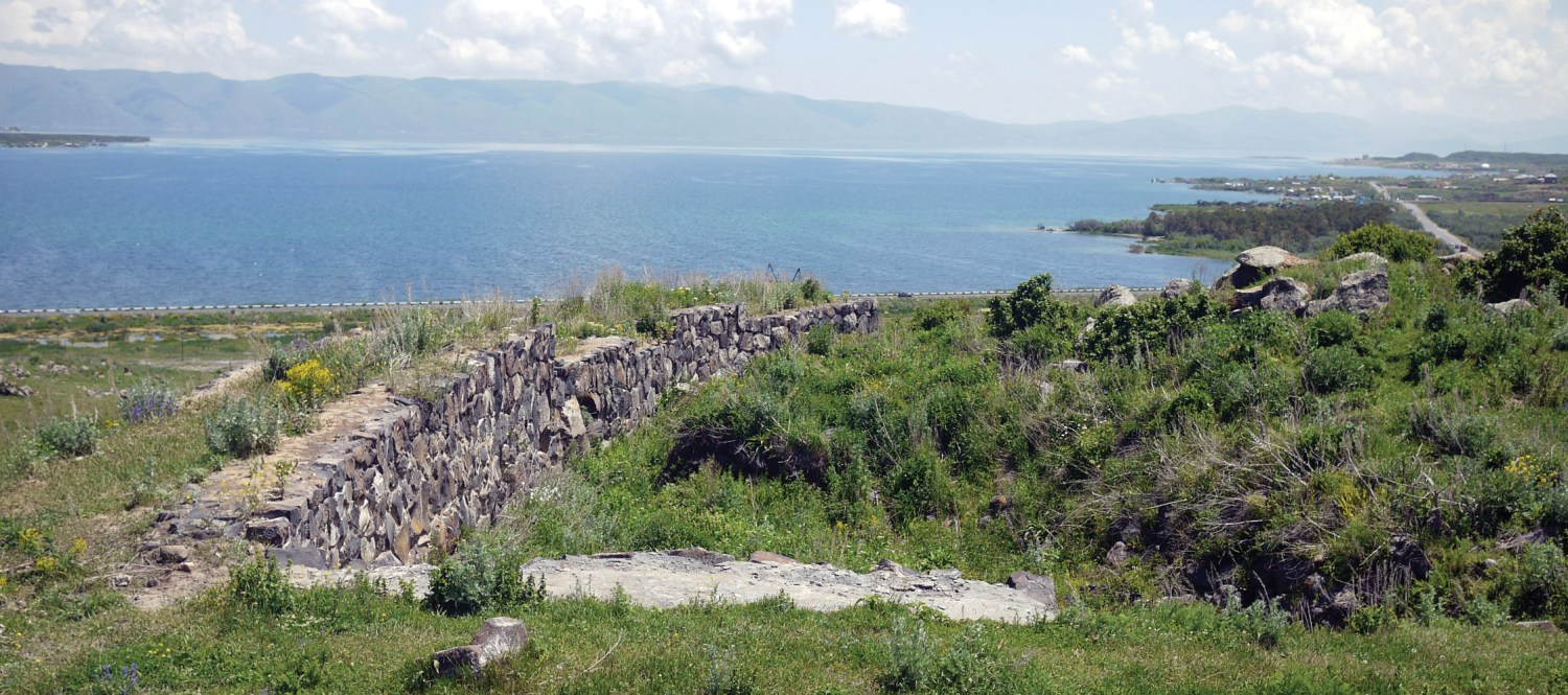 top Lake Sevan, as seen from the Lchashen hillfort, and the view of the barrow field (Inset) that was revealed when the water level was lowered by the Soviets.