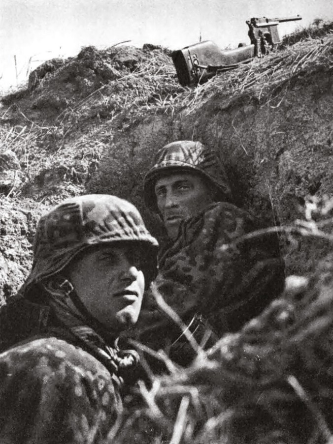 ABOVE RIGHT Waffen SS take shelter in a slit trench.