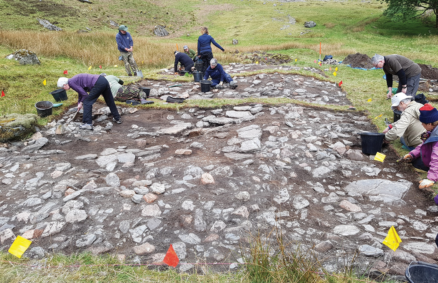 BELOW Although much of Structure 1's stone had been robbed out for later building projects, its paved floor remained largely intact, suggesting that this surface had been overgrown and hidden at the time of the recycling.