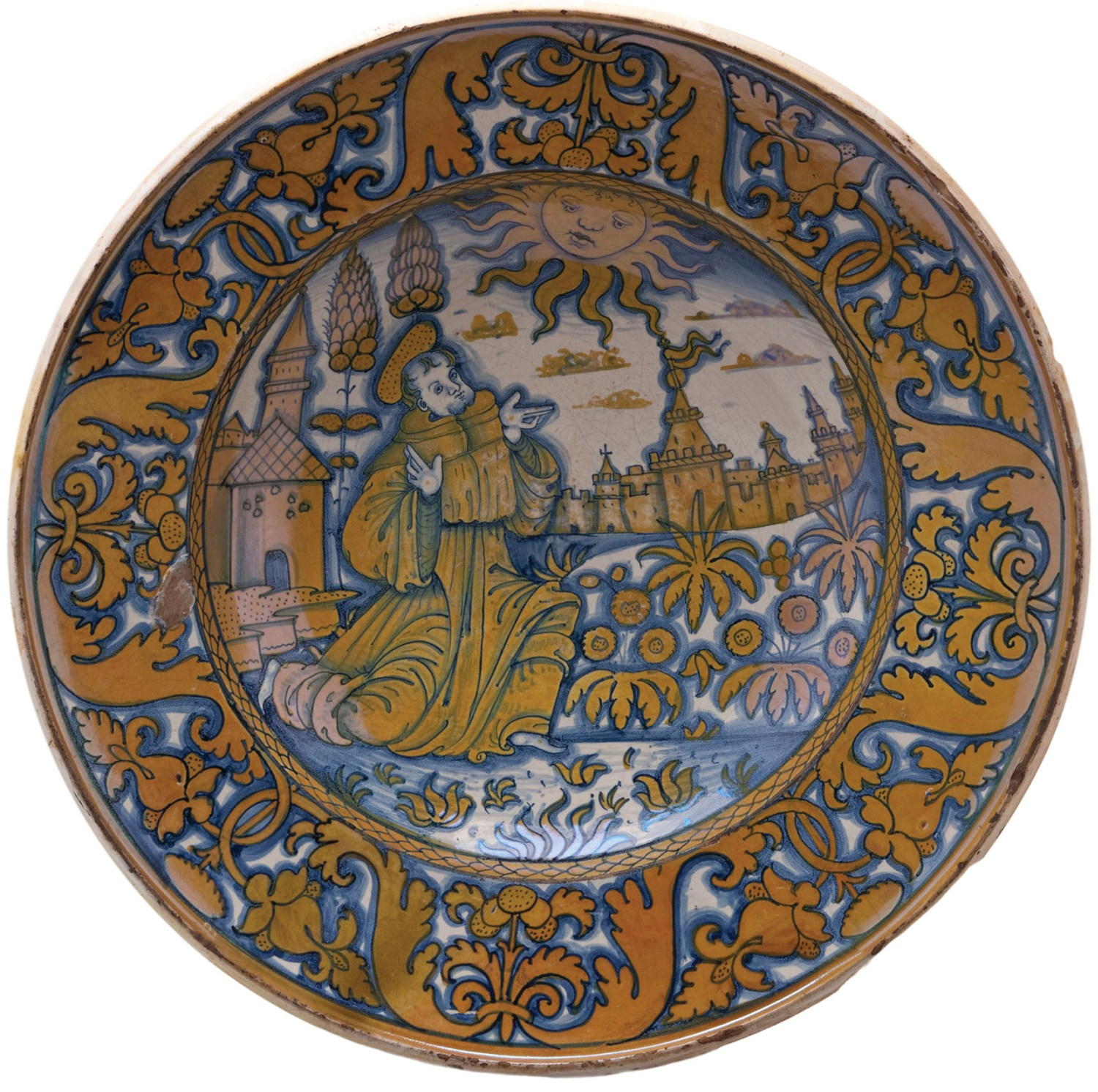 Right A similar maiolica plate showing St Francis composing the Cantico di frate sole. Made in Deruta, c.1515. Size: 42cm in diameter