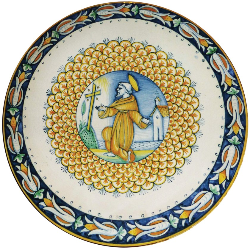 right A modern piatto di pompa with St Francis in front of a cross. Size: 31cm in diameter