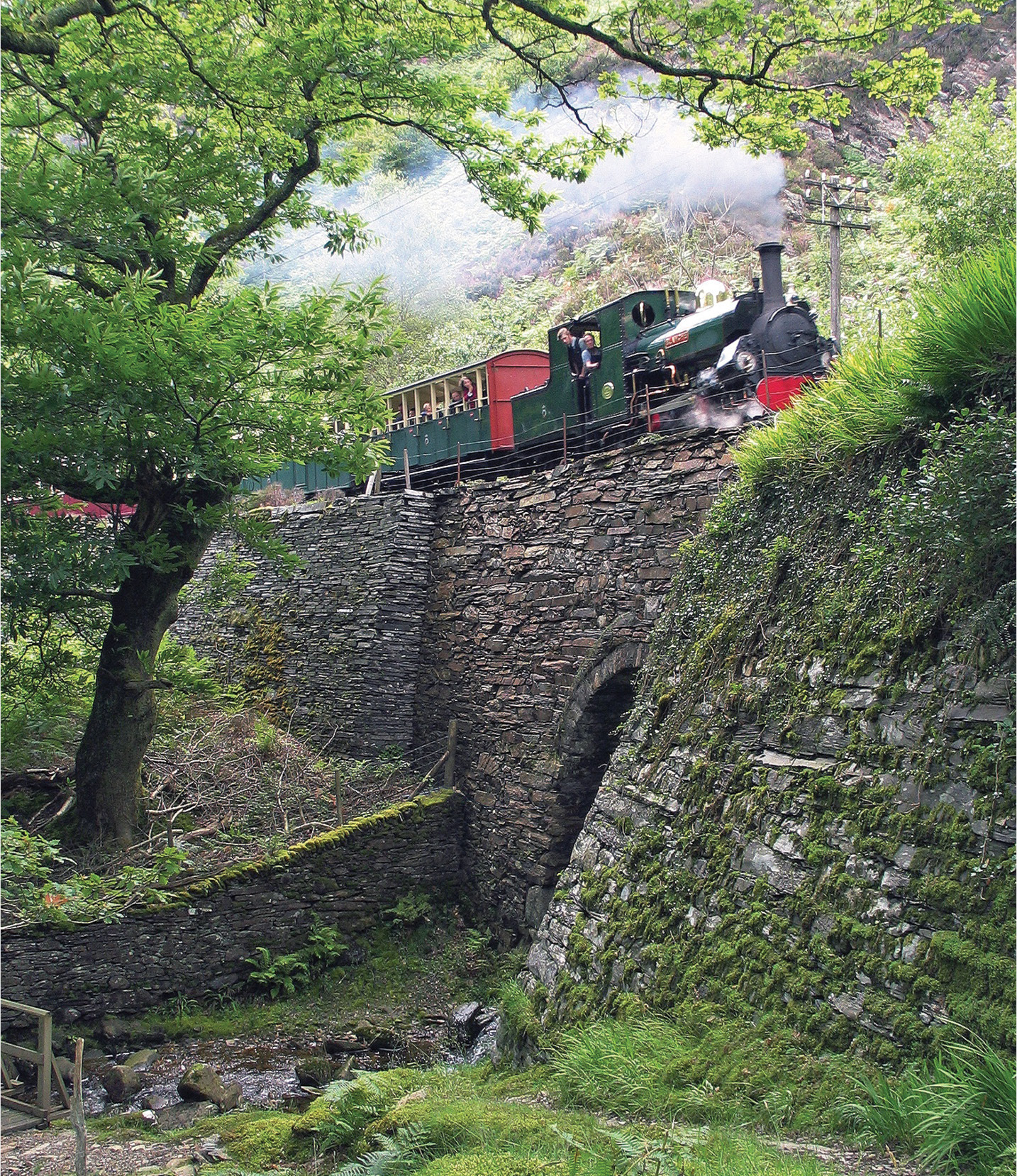 above Now a major tourist attraction, the narrow-gauge Ffestiniog railway was built in 1836 to carry slate from Ffestiniog to Porthmadog Harbour. The 2ft (0.6m) gauge was a practical response to the challenges of creating a railway track in mountainous terrain. Contemporary with Brunel's pioneering Great Western Railway, the Ffestiniog influenced the design of narrow-gauge railways around the world, including the Darjeeling Himalayan Railway, which was inscribed in the World Heritage list in 1999.