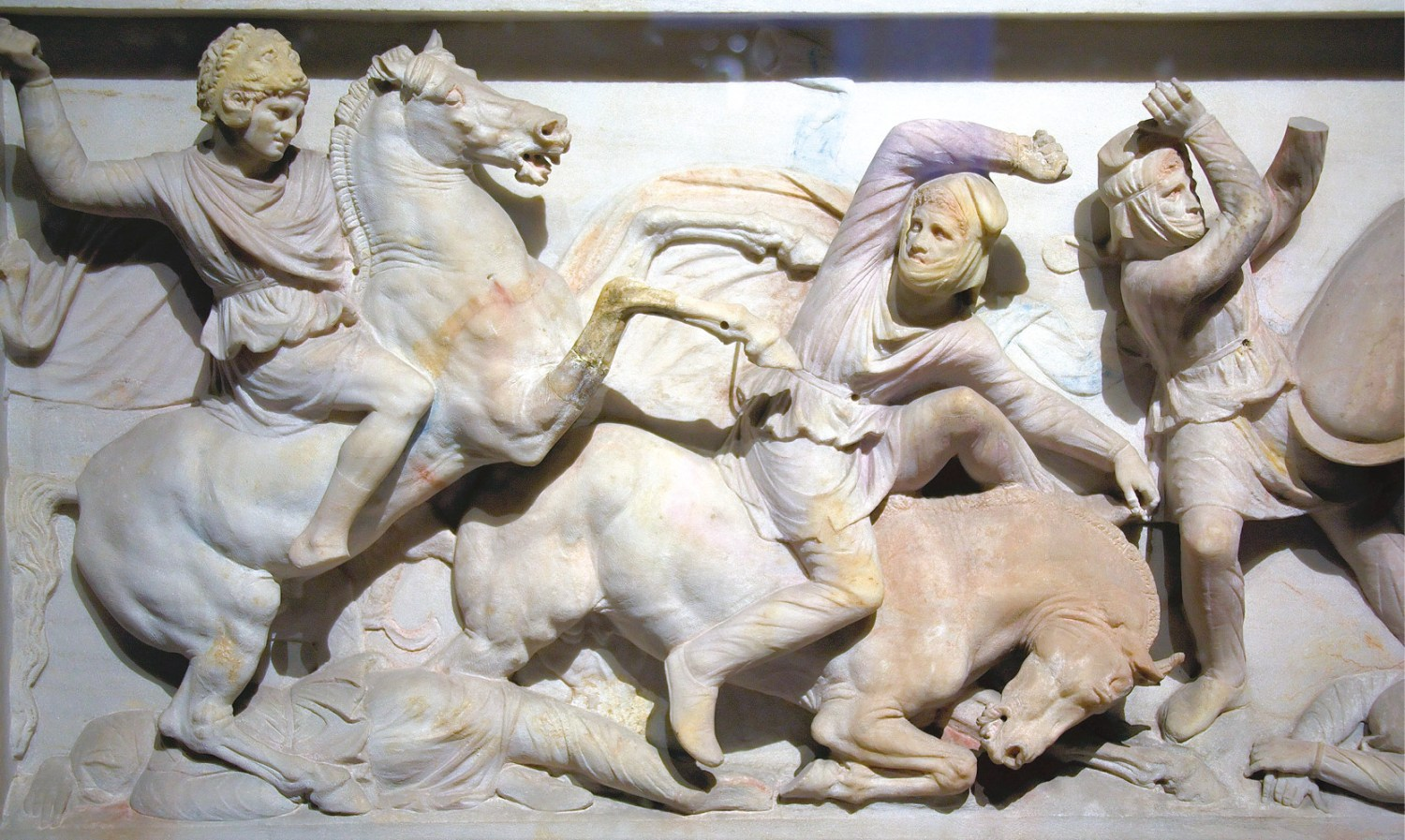 Two scenes from the Alexander Sarcophagus (on display in Istanbul's antiquities museum). Alexander appears in the guise of a Homeric hero, wearing the lion skin of Heracles, in the thick of the fighting [LEFT]. The colourised reconstruction closer to the probable original appearance underlines the dichotomy between West and East that was fundamental to the Hellenic world-view [BELOW LEFT].