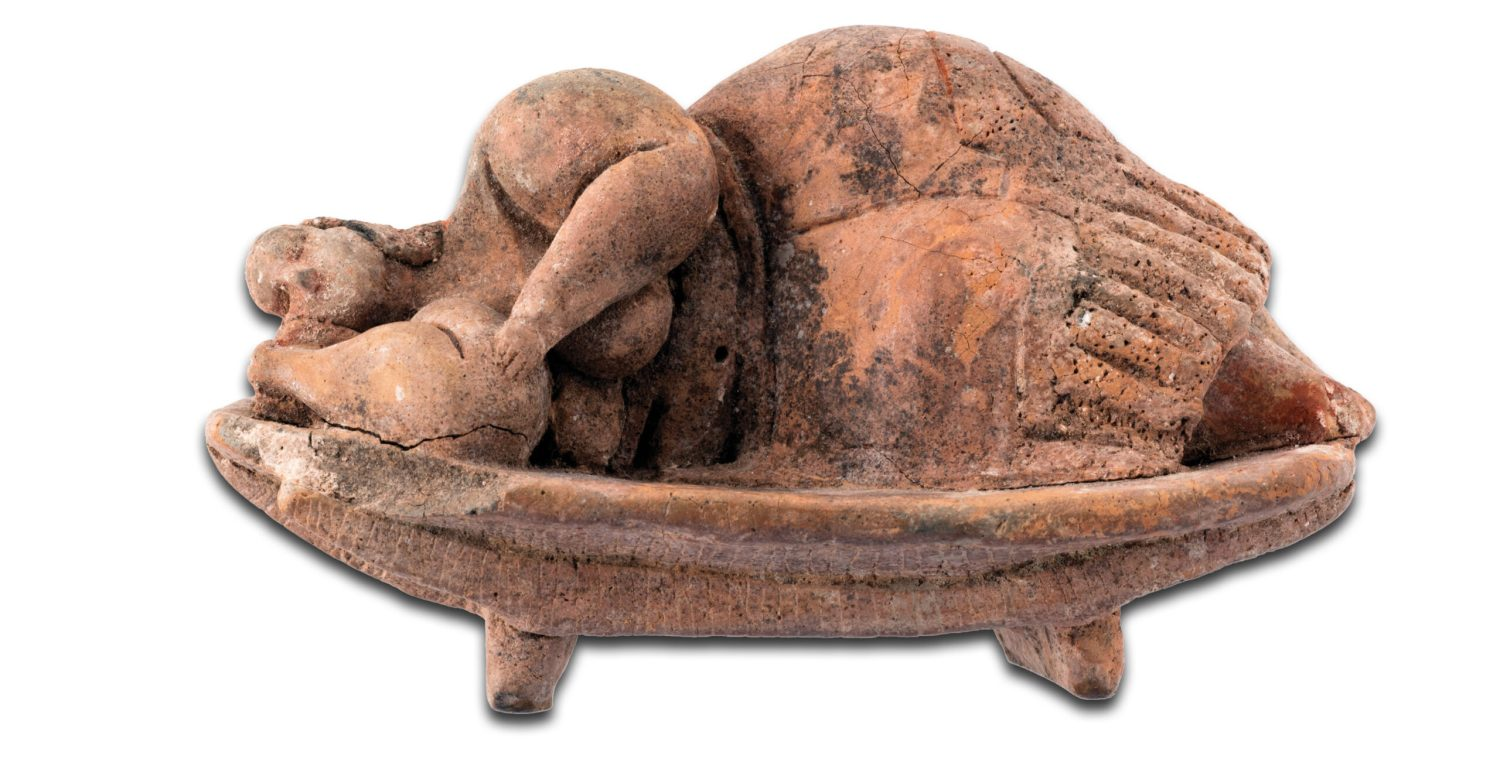 Above The Sleeping Lady, discovered in the Ħal Saflieni hypogeum, 3000-2450 BC. Size: 6 x 12 x 6.6cm