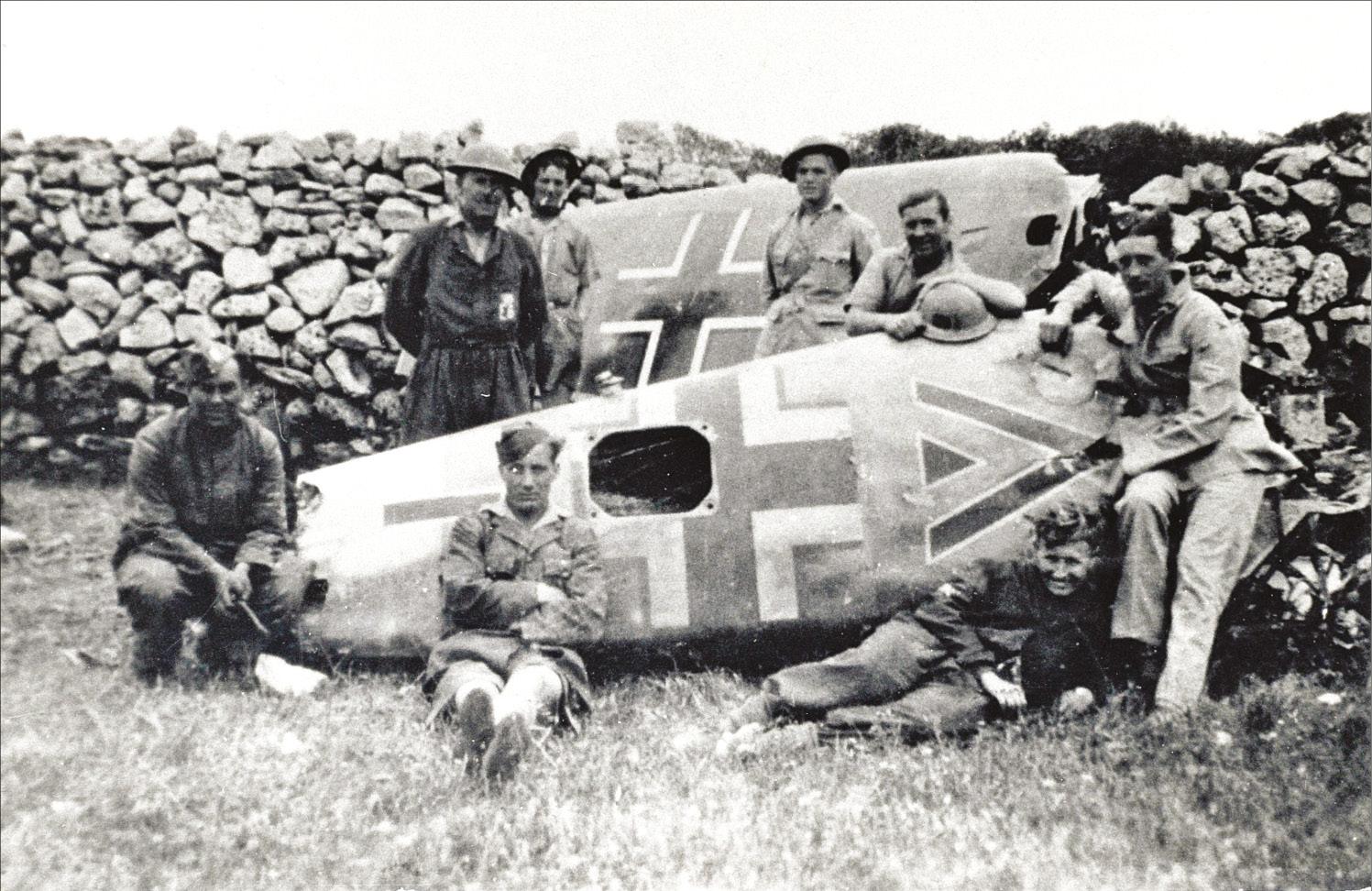 BELOW Wreckage of Hauptmann Krahl's Bf 109, with the distinctive Gruppenkommandeur chevron/triangle on the fuselage.