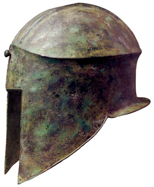 Above Greek hoplite helmet of 'Illyrian' type (in contrast to the 'Corinthian', which extended coverage across the cheeks and down the nose to leave only eyes and mouth exposed). Equipment was supplied by the individual soldier. Items were often passed down the family line. Sometimes they were ritually dedicated in temples, and for this reason a good number of helmets, breast-plates, and shields have survived to be studied and compared with the images on painted pottery and sculpture.