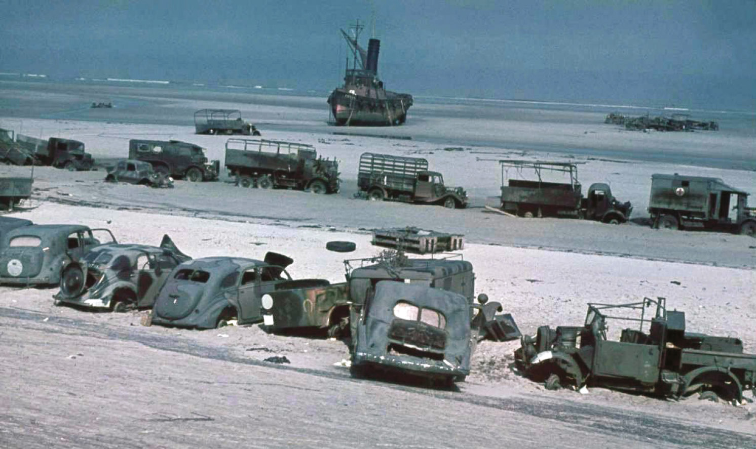 ABOVE Abandoned British kit on the Dunkirk beaches. But 340,000 men were evacuated saving the British Army for the defence of Britain and creating the nucleus of De Gaulle's Free French. This was all thanks to General Gort who disobeyed orders, retreated to the Channel, and was soon thereafter sacked.