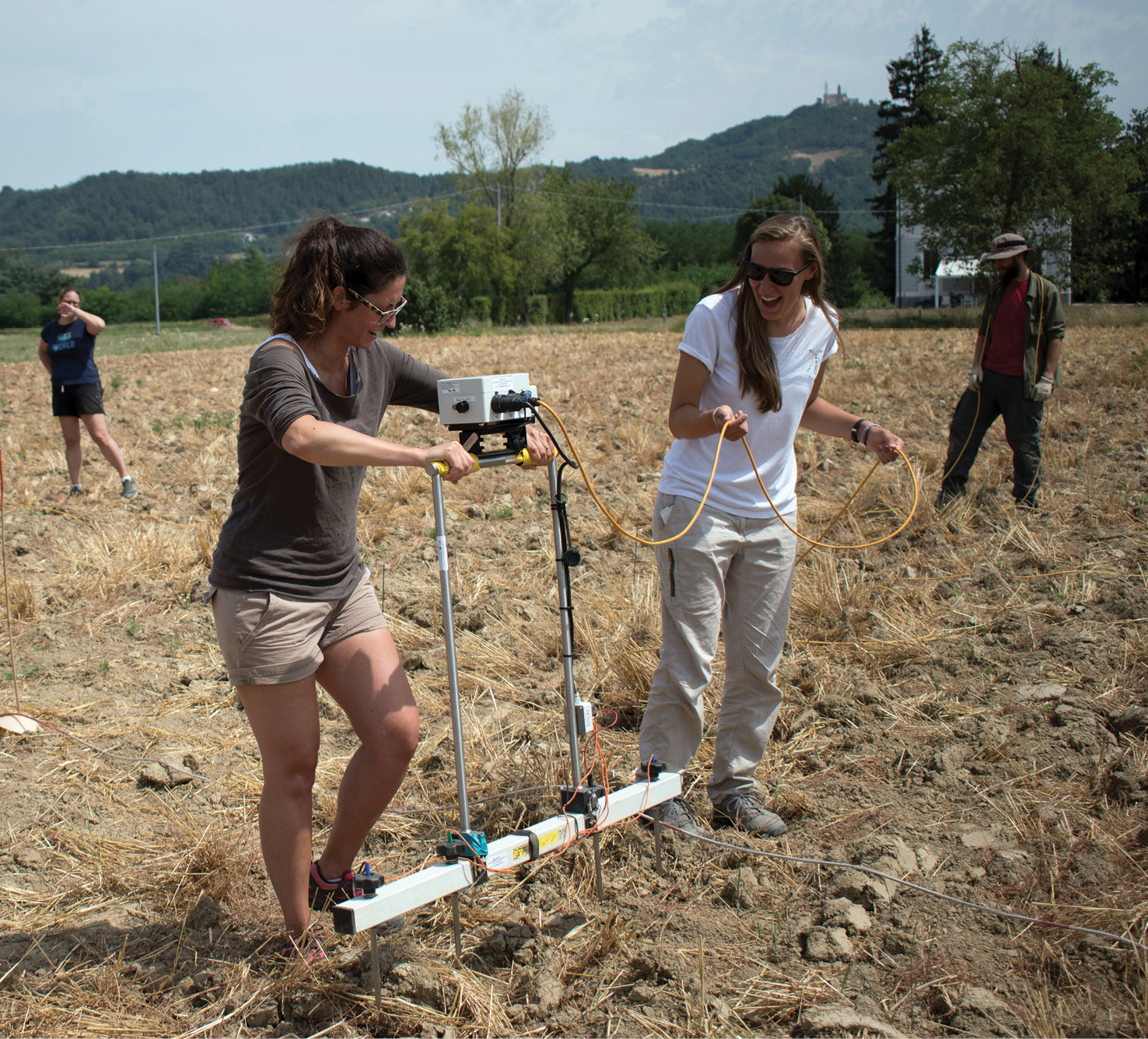left T M Cazzulo and team member Shura Harris using the electrical resistivity probe in one of the fields that now overly the site of Libarna.