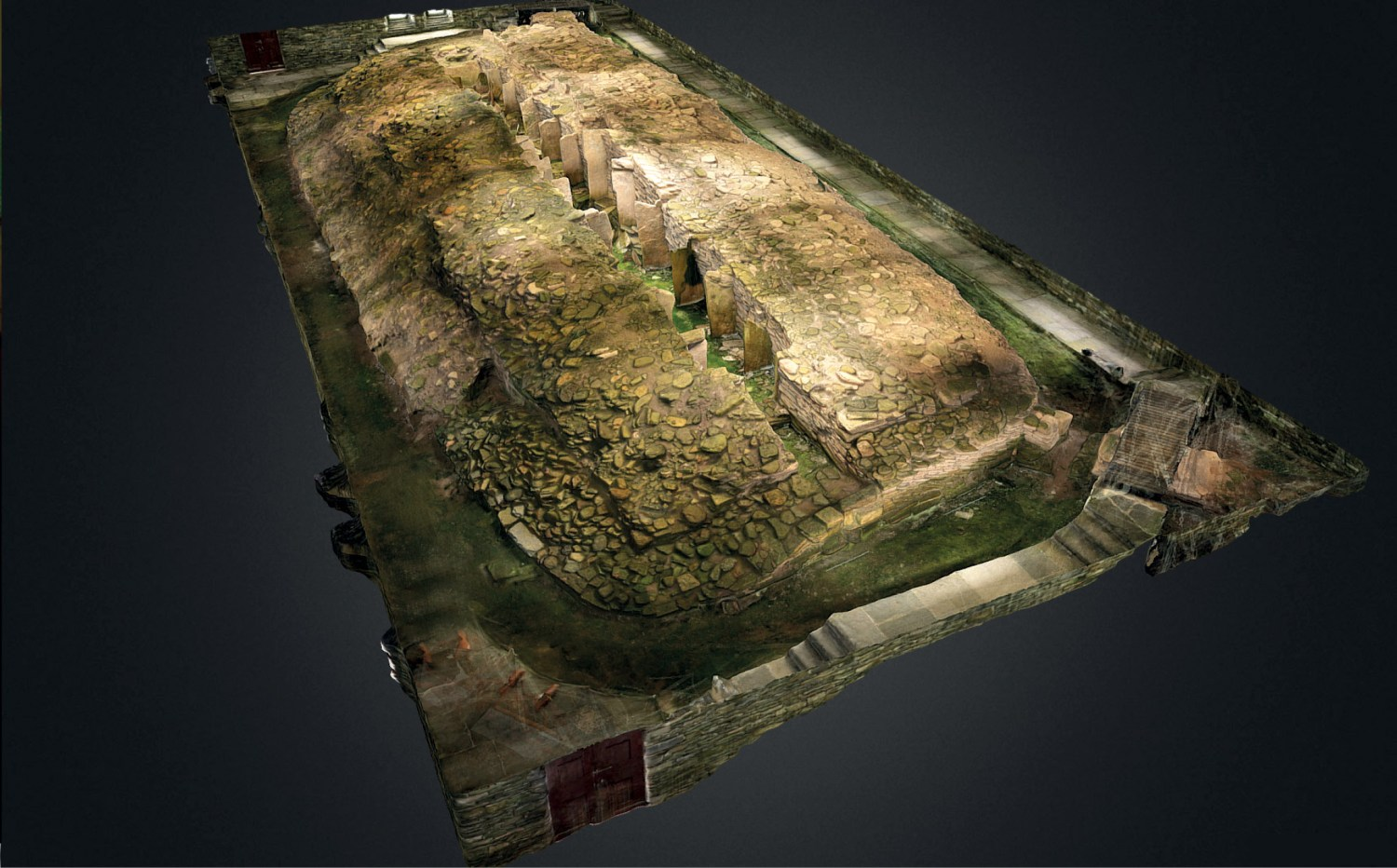 below This digital model shows the pairs of upright slabs dividing the long internal chamber of Midhowe stalled cairn but also illustrates the difficulties of creating such models: skylights in the modern metal hangar covering the tomb have given its virtual outer surface a striped appearance.