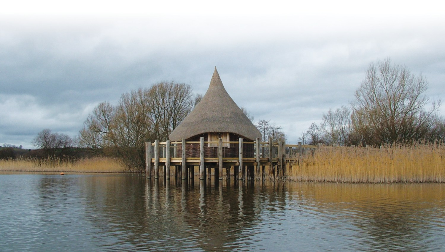 below The Welsh Crannog Centre opened in 2004 on the north side of the lake, with a viewing platform and information on the lake's history, folklore, flora, and fauna. Its circular form is based on a 19th-century depiction of a Scottish site. It is now available as a wedding venue!