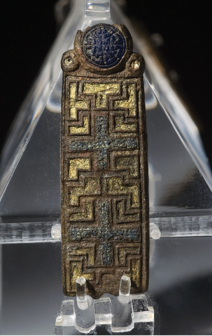 above left The Llangorse reliquary mount, made of bronze inset with glass and enamel. above The Irish-style brooch terminal decorated with interlace, egg-and-dart, and animal heads.