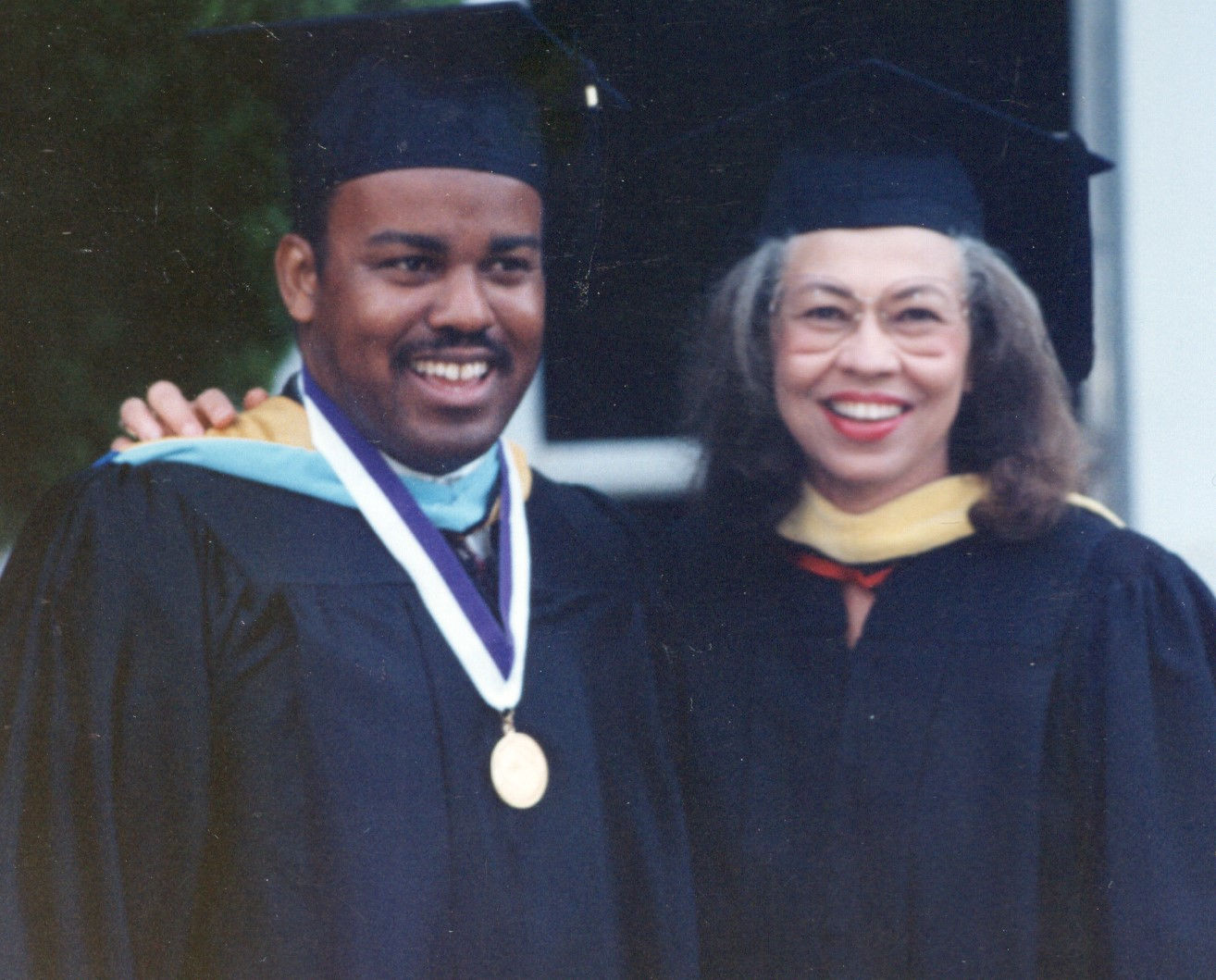 Hampton at graduation ceremony with former SJCC President Del Anderson